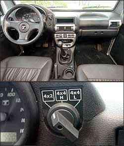 Aro do volante é muito fino e relação de direção muito indireta. Engate do sistema de tração é por meio de botão no painel -